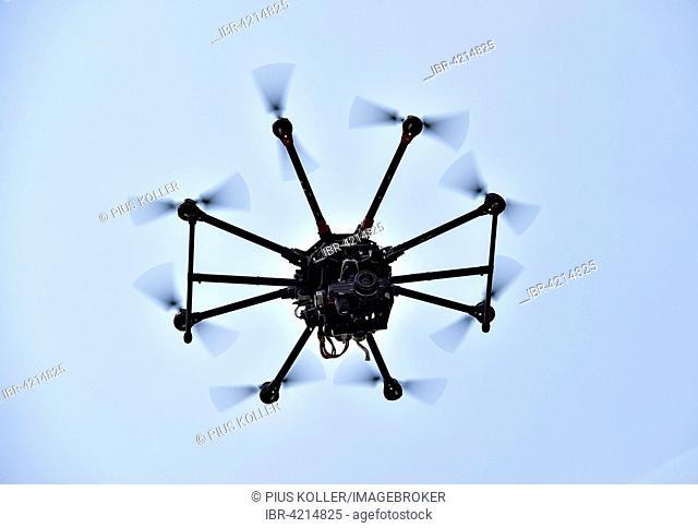 Drone in flight, carrying a single lens reflex camera, DSLR