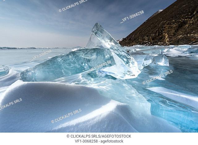Pieces of transparent ice with sun reflection at lake Baikal, Irkutsk region, Siberia, Russia