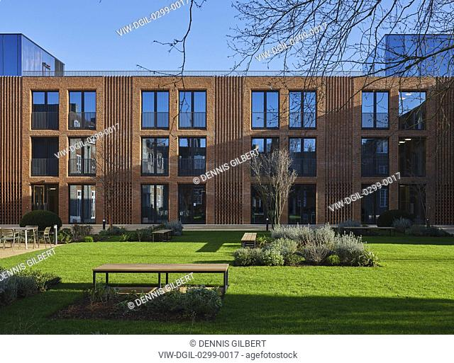 Landscaped garden and sunlit facade. Newnham College, Cambridge, Cambridge, United Kingdom. Architect: Walters and Cohen Ltd, 2018