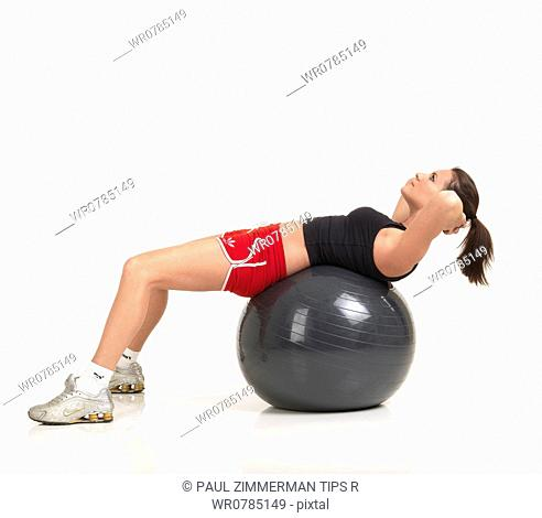 Woman exercising with fitness ball,studio shot