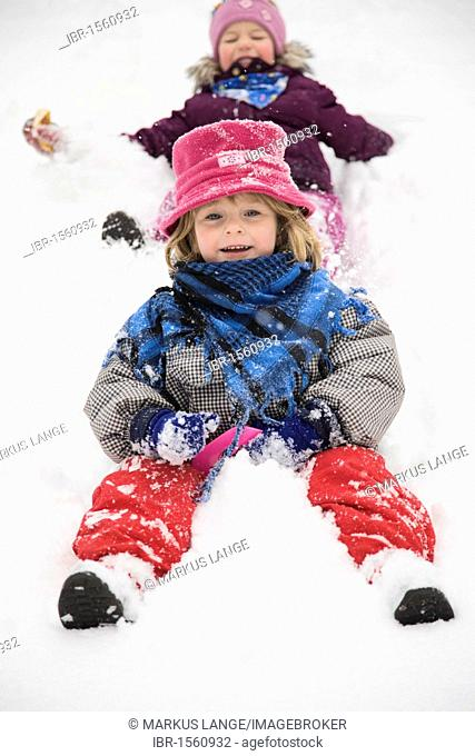 Two girls with sleds