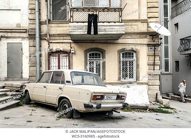 baku city old town street view in azerbaijan with vintage old soviet car