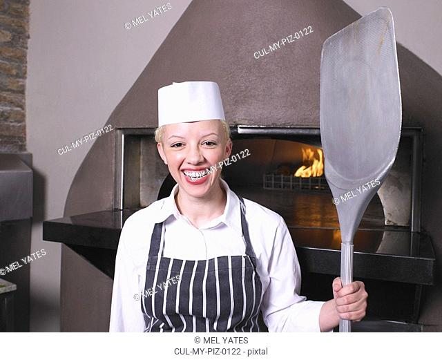 Pizza chef in front of oven