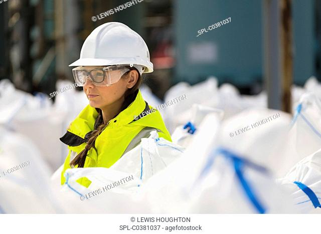 MODEL RELEASED. CalaChem chemical factory. Worker with sacks of flutriafol fungicide produced at the CalaChem processing plant Grangemouth, Scotland, UK
