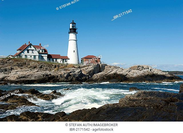 White lighthouse, waves breaking on rocks, Portland Head Light, Portland, Cape Elizabeth, Maine, New England, USA, North America, America