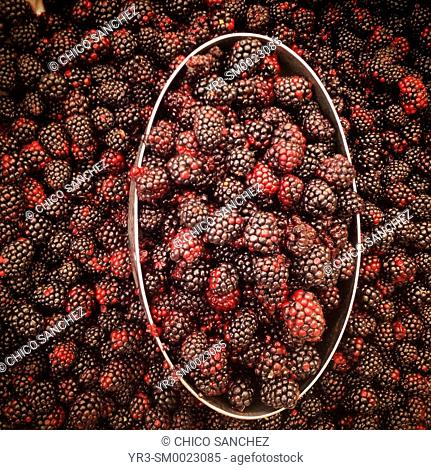 Red berries for sale in a market in Mexico City, Mexico