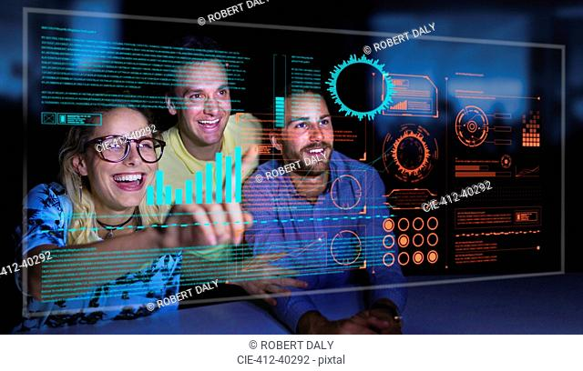 Enthusiastic business people using futuristic hologram computer