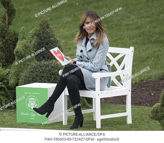 """First lady Melania Trump reads the book """"""""You,"""""""" by Sandra Magsamen as she and United States President Donald J. Trump host the annual White House Easter Egg..."""
