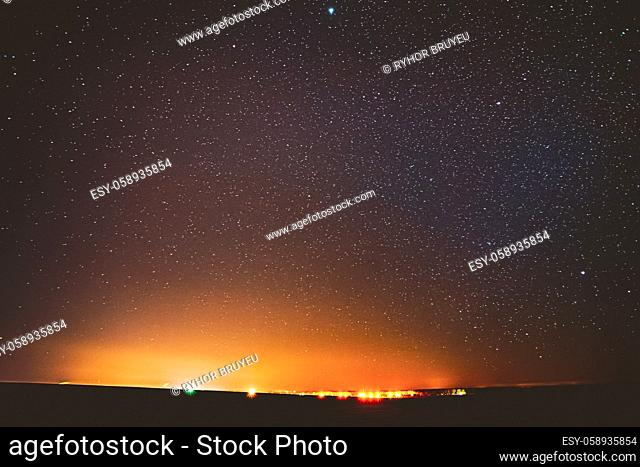 Night Sky Glowing Stars Background Backdrop. Colorful Sky Gradient. Sunset, Sunrise And Town Lights At Horizon. Colourful Night Starry Sky In Yellow Orange...
