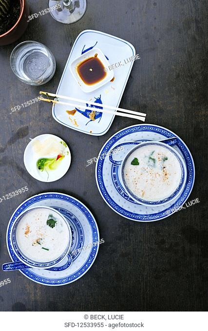 Coconut soup with coriander in chinese bowls