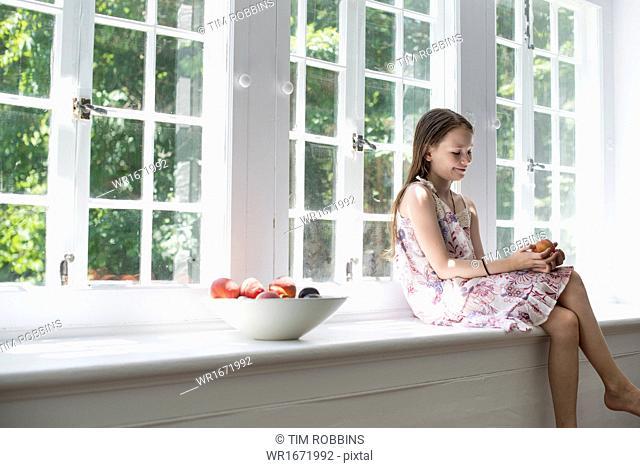 Girl sitting by a window