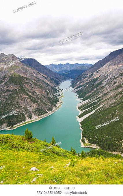 Aerial view of Livigno lake in Alps Mountains, Lombardy, Italy