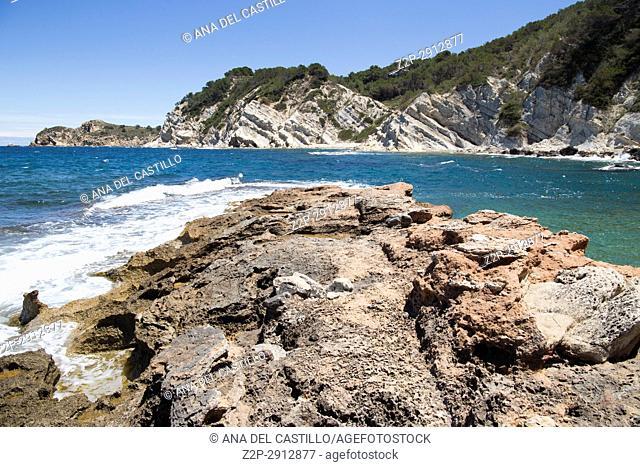 Rocky coast in Cala Blanca Javea Alicante Spain