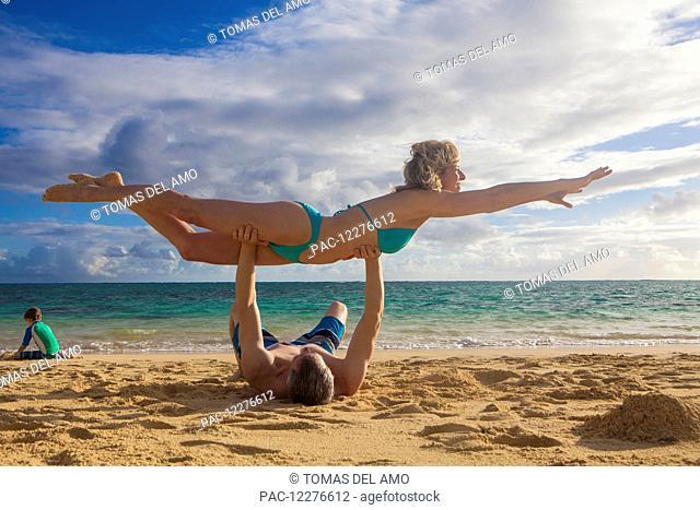 Family playing on the beach; Kailua, Island of Hawaii, Hawaii, United States of America