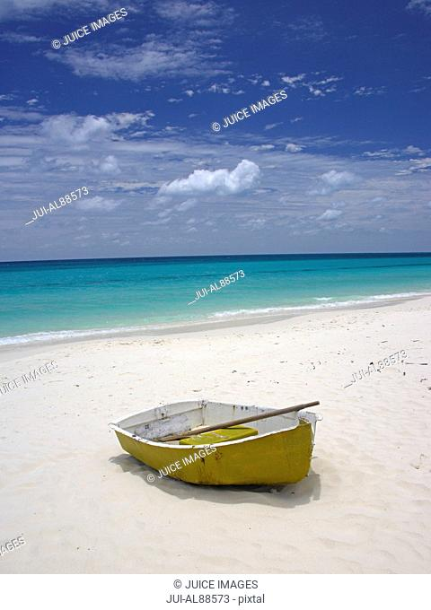Little Boat at the white Beach of Ouvea Island, Loyalty Islands, New Caledonia, Overseas Territory of France