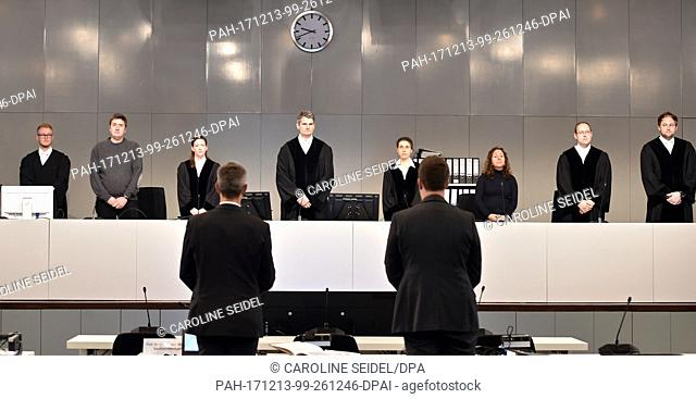 Judge Mario Plein (4th l) stands in the court room at the Loveparade trial in Duesseldorf, Germany, 13 December 2017. The district court Duisburg rented a hall...