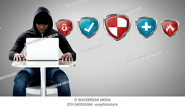 Antivirus security protection shields and scam hacker on laptop