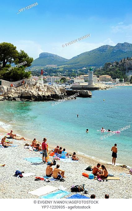 People bathing in Cote de Azur public beach  Riviera seashore in Nice, France