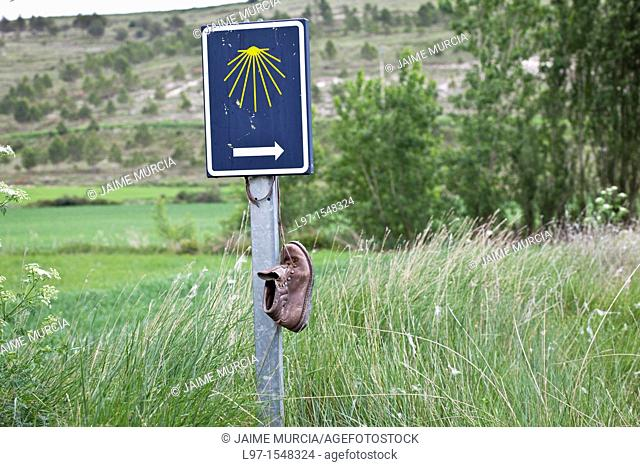 Boot hanging from a pilgrim way marker along the Camino de Santiago, route Frances