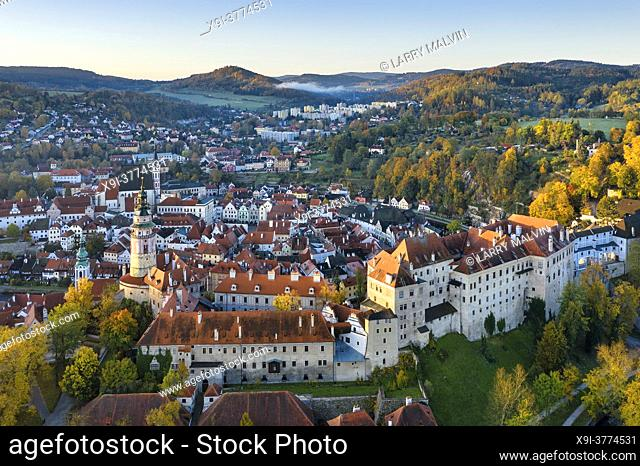 Aerial view just after sunrise of the castle in the picturesque, fairy tale town of Cesky Krumlov, a UNESCO-designated World Heritage Site in the South Bohemia...