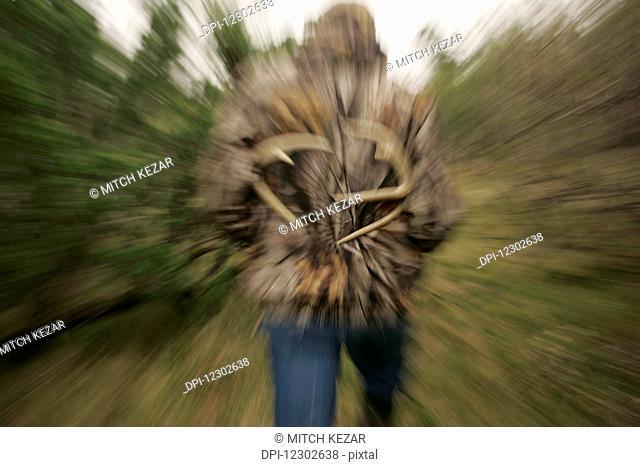 Whitetail Deer Hunter Motion Blurred