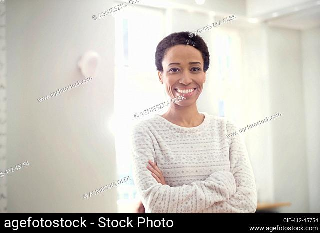 Portrait confident, smiling woman with arms crossed