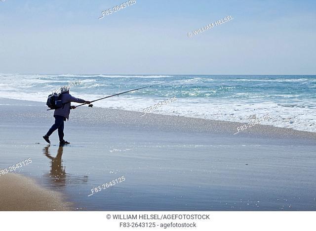 Surf fisherman casting on state beach, Santa Barbara County, CA, USA