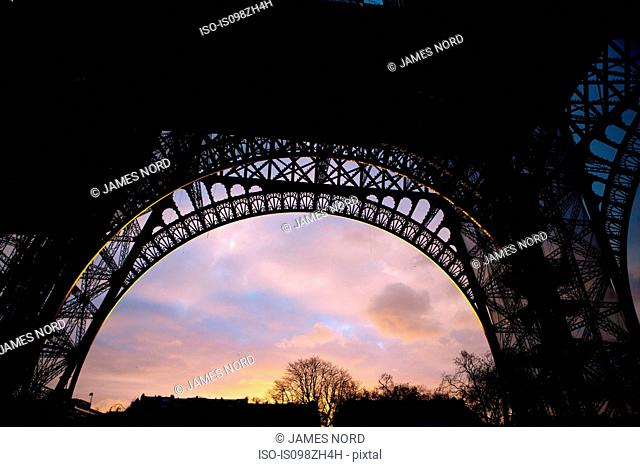Underneath Eiffel Tower at sunset, Paris, France