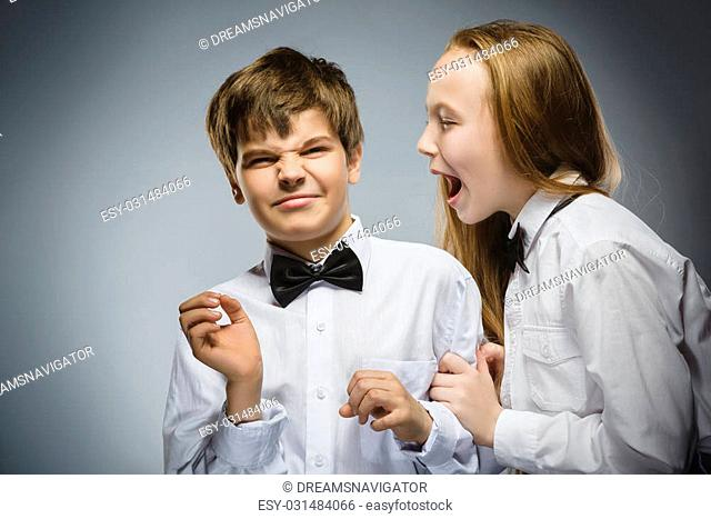 angry girl shouting at frightened dissatisfied boy. Negative human emotion, facial expression. Closeup. Communication concept