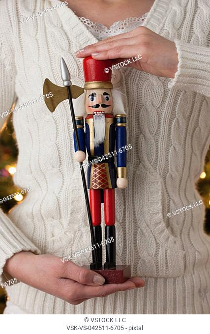 USA, Illinois, Metamora, Close up girl 10-11 holding figurine of soldier in historical clothing