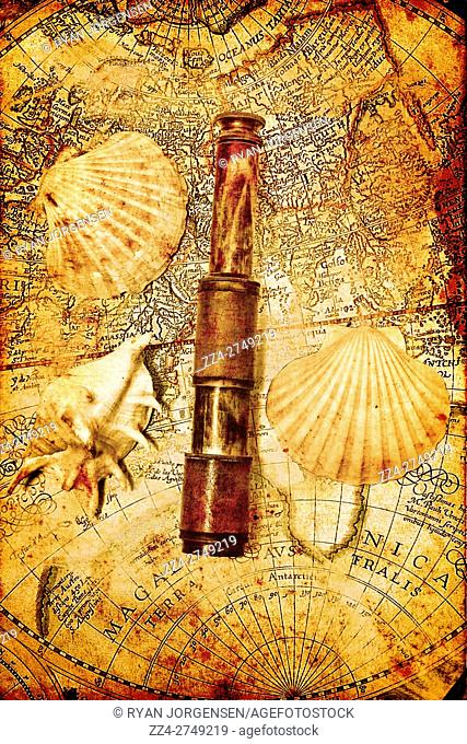Marine sea exploration details on a map seashells and telescope on faded antique voyage map. Ocean adventures