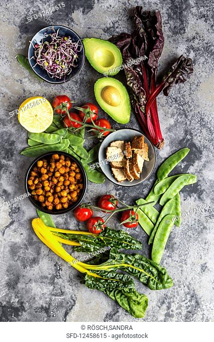 Fried chickpeas, tomatoes, avocado, chard, mangetout, smoked tofu, sprouts and lemon