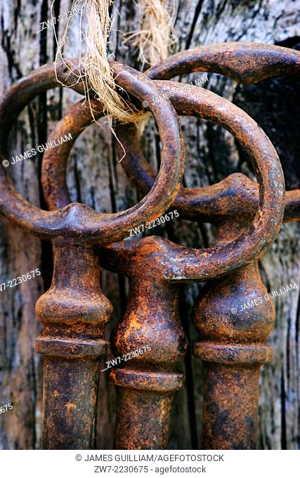 Close up of a tied bunch of rusty antique keys