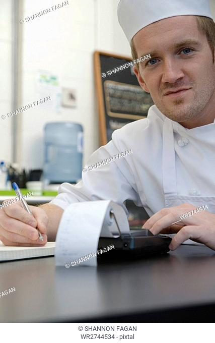 Chef with calculator