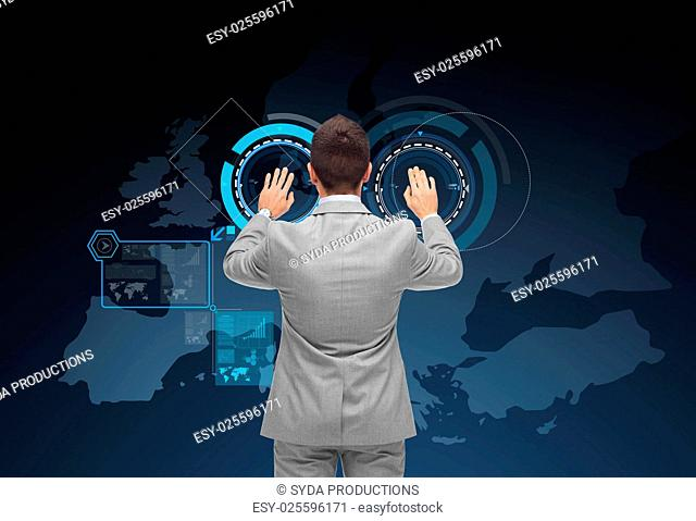 business, people, communication, navigation and technology concept - businessman using virtual screen with map of europe over dark blue background