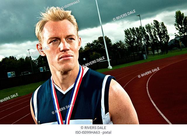 Sprinter with medal on sportstrack