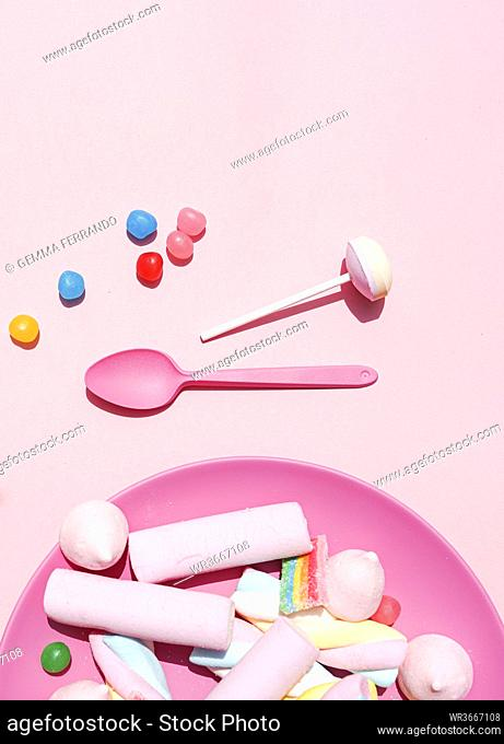 Studio shot of plastic plate filled with various sweets