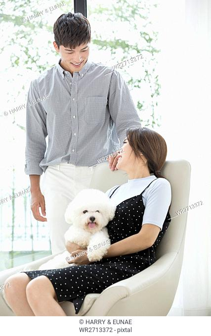 Loving couple with pet