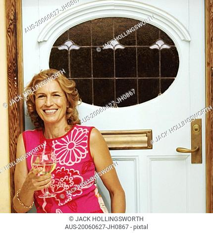 Portrait of a mature woman holding a glass of white wine