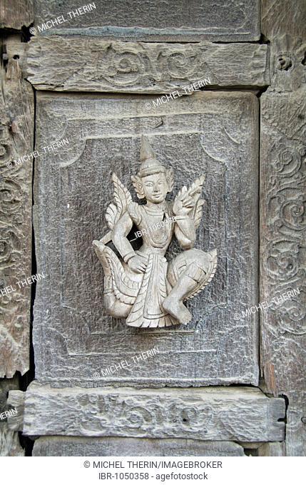Carved figure on a teak door, Monastery Shwe In Bin Kyaung, Mandalay, Burma, Myanmar, Southeast Asia