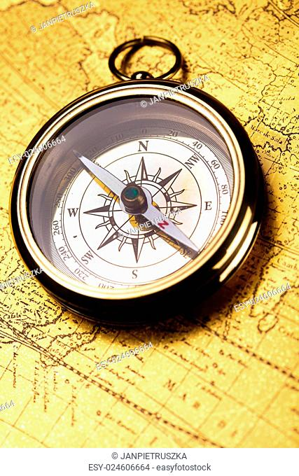 Compass on the old map background