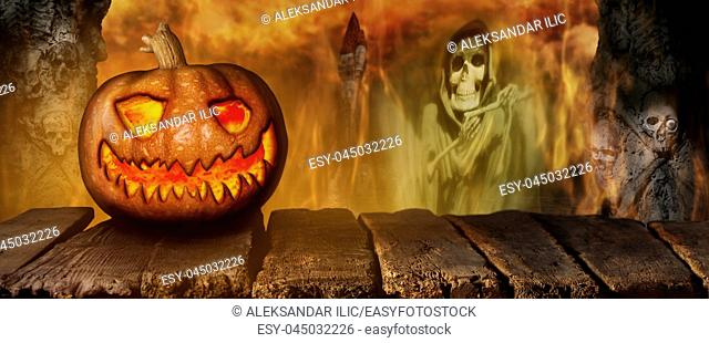 Spooky Halloween Pumpkin On a Wooden Table at Night . With Mistery Horror Background With Cemetery, Death Reaper, Smoke and Fire 3D Illustration