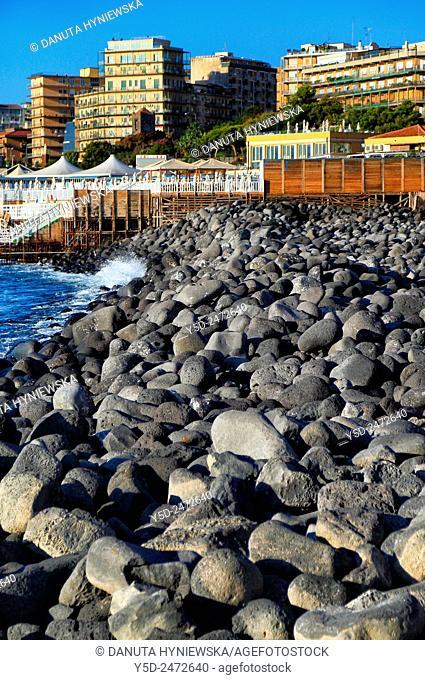 Black beach from volcanic lava from Etna volcano, Aci Castello, Province of Catania, Sicily, Italy