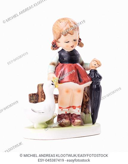 Very old statue, small ceramic girl with a goose, isolated on white