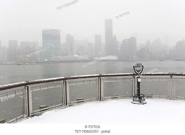 USA, New York City, coin operated binoculars overlooking foggy Manhattan