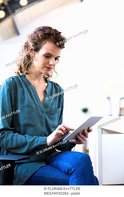 Young woman using tablet in office