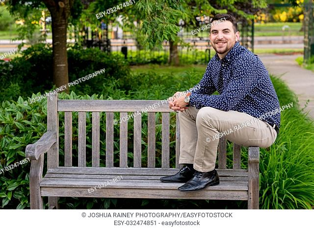 College grad student on a park bench on a beautiful university campus in the Spring