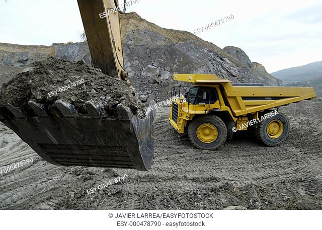 Loading rocks at quarry, Hydraulic Excavator, machinery for public works