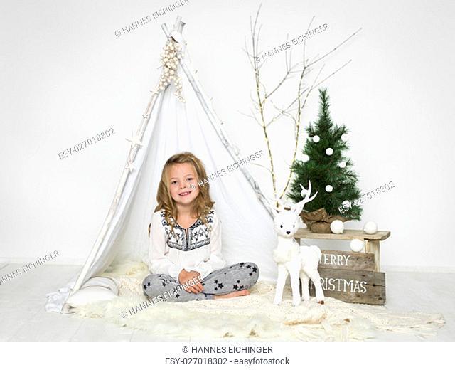 girl in studio with festive setup