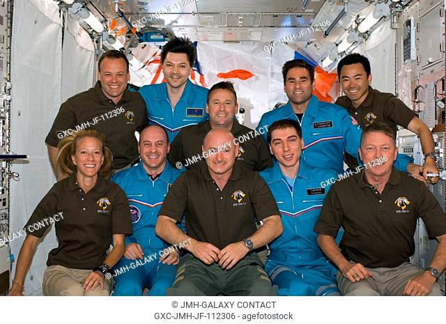 The STS-124 and Expedition 17 crewmembers pose for a group portrait following a joint news conference from the newly installed Kibo Japanese Pressurized Module...